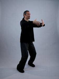 Master Tan Standing Pose